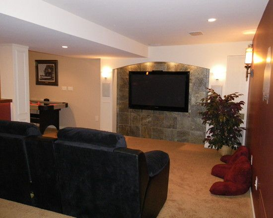 Nice Stone Tile Wall Behind The TV Unit Looks Unique Since It Is Not Used As  Fireplace