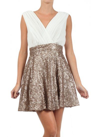 100 percent Polyester 1S/1M/1L Per Pack Mocha (shown), Black This HIGH QUALITY dress is VERY NICE! Made from a comfy duo fabric, this wrapped tank dress has a pleated bodice, sequined A-line skirt, and a low back with zipper closure fits true to size.