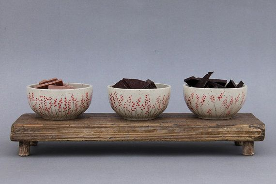 Handmade serving set three ceramic bowls on wooden by studiowetwo