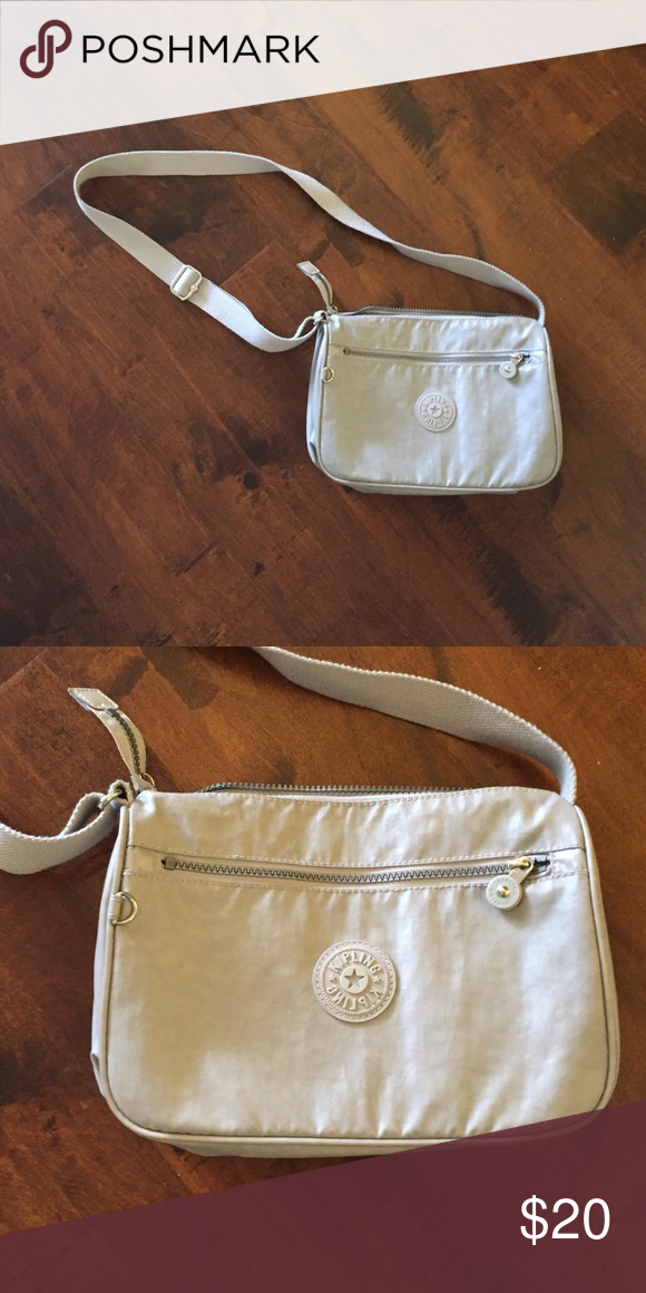 Gray Kipling purse Barely used gray Kipling purse. It doesn't have the monkey. Only avail to 9/19 Bags Crossbody Bags