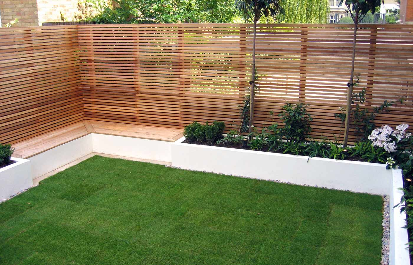 built in seating, red cedar fencing in putney garden | gardens