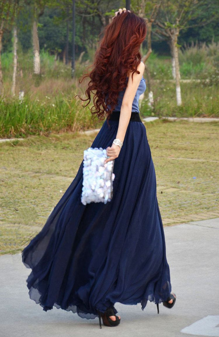 flowy maxi skirt, same color top, sparkly clutch, and curls ...