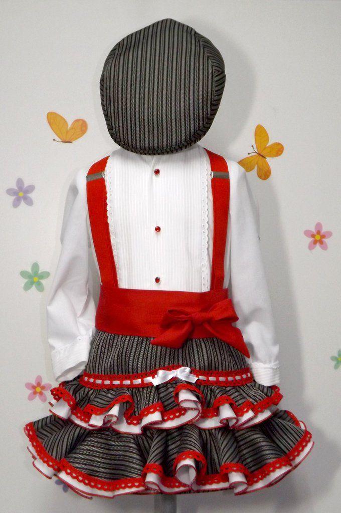 Conjunto campero de falda y camisa para niña. Falda con dos volante y camisa  con pecherín de jareta adornado con botones de cristal rojo. a3f7c6fb82d