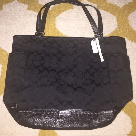 Amazing Large Black Coach handbag Amazing Large Black Coach handbag with silver accents and black liner. This purse is wonderful and great for traveling. It has 3 incredibly convenient pockets on the outside, 1 on each end and 1 large on the back. These pockets are great for storing cell phones and sunglasses for easy access. Only mark on this purse is a small white mark on the bottom. Coach Bags Shoulder Bags