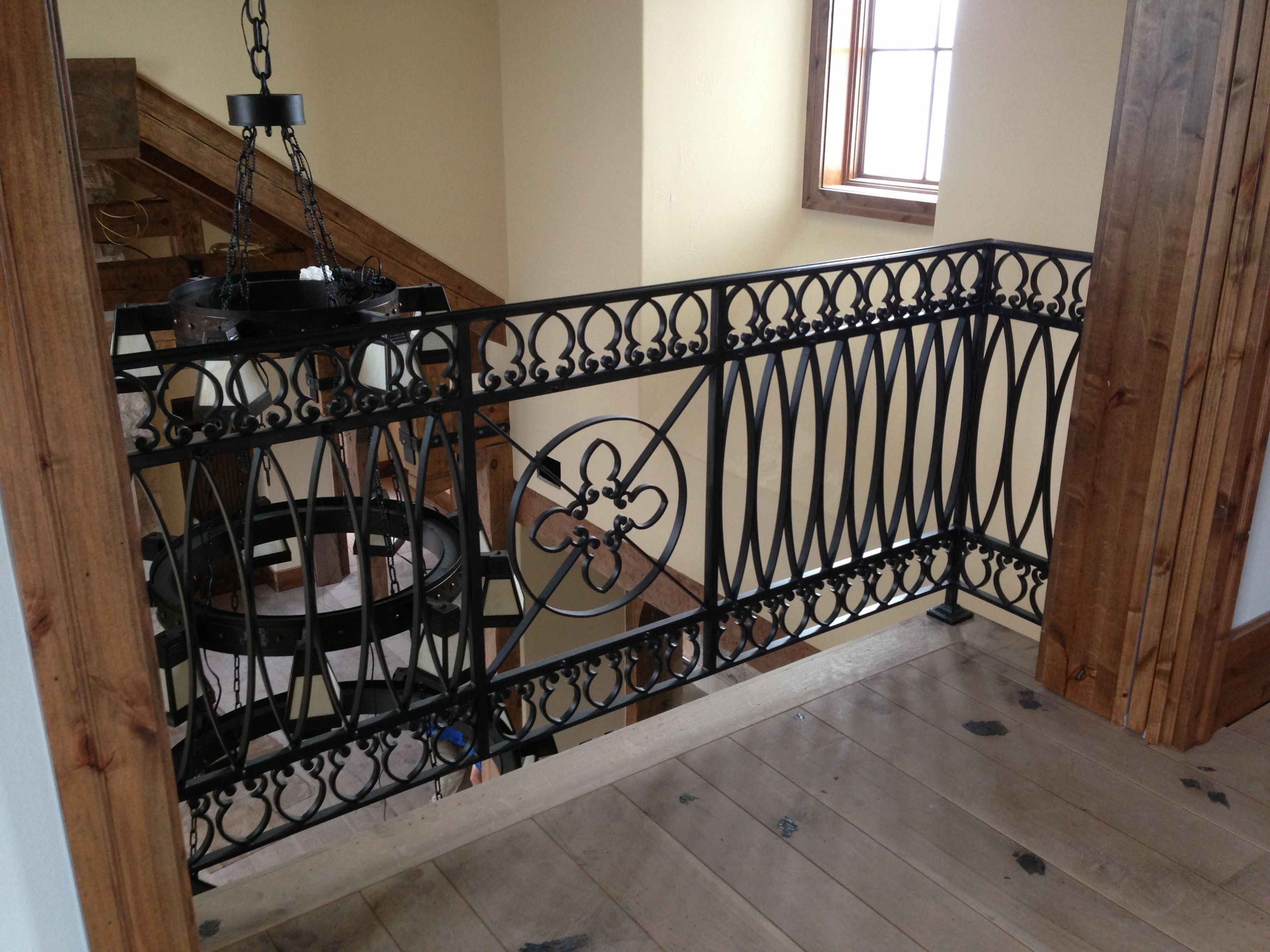 Custom Wrought Iron Interior Railing With Oval Pickets, Scroll Work, And  Decorative Centerpiece.