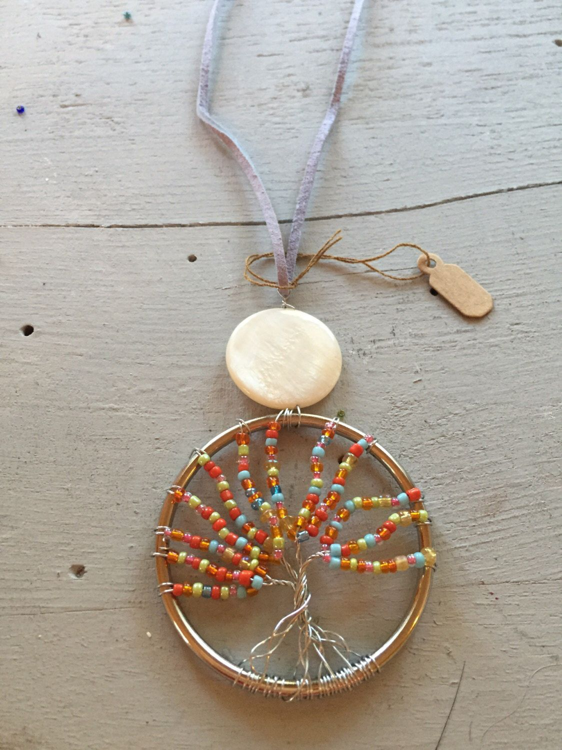 A personal favorite from my Etsy shop https://www.etsy.com/listing/462877922/2-pendant-wire-wrapped-tree-of-life