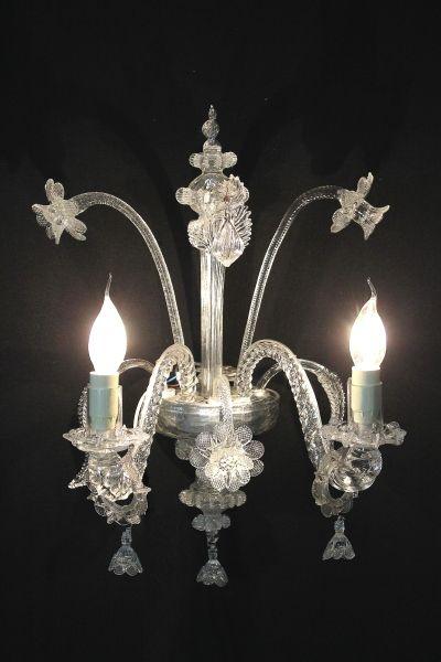 Applique 2 luci trasparente foglie e fiori. Comprensiva di 2 lampadine chiare colpo di vento 28W E14.