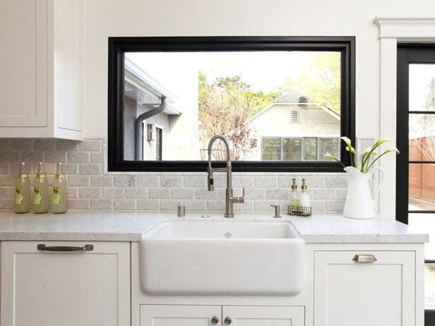 Black Window Trim Is A Feature In An All White Farmhouse Kitchen