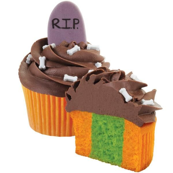 Buried beneath the spooky headstone and chocolate icing swirl is a haunting cupcake color combo. When folks dig in, they'll find a glowing green center inside the orange cupcake! Wilton's Two-Tone Cupcake Pan Set separates different batter colors for a thrilling treat.