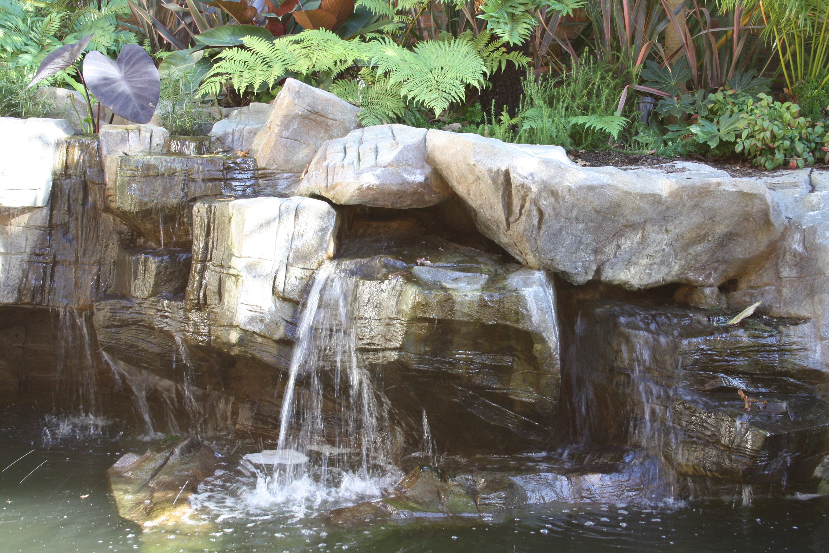Natural rock sculpture with wetland filtration and for Water feature filtration system