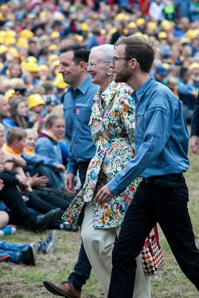 Queen Margrethe (C) walks from the FDF summer camp stage, where she held the official opening speech, to her seat where she will watch a show together with the 11.500 scouts attending the camp in Ry, Denmark, on July 7, 2016. The Queen is protector of the FDF scout organization.