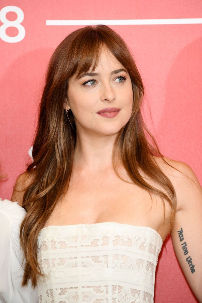 17 Wispy Bangs Styles From Celebs Whose Bangs Are Always Quot Too Good Quot Dakota Johnson Hair