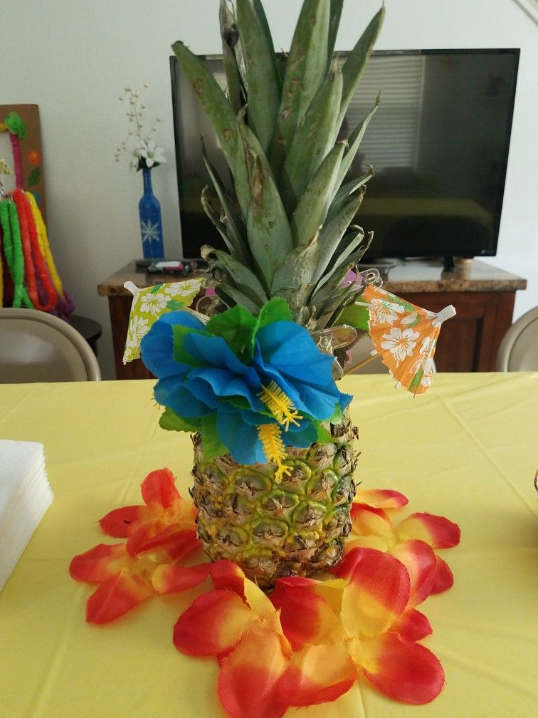 Hawaiian Party Table Centerpiece Very Simple Attach Flowers To A Natural Pineapple And Done Luau Party Decorations Holiday Party Themes Luau Decorations