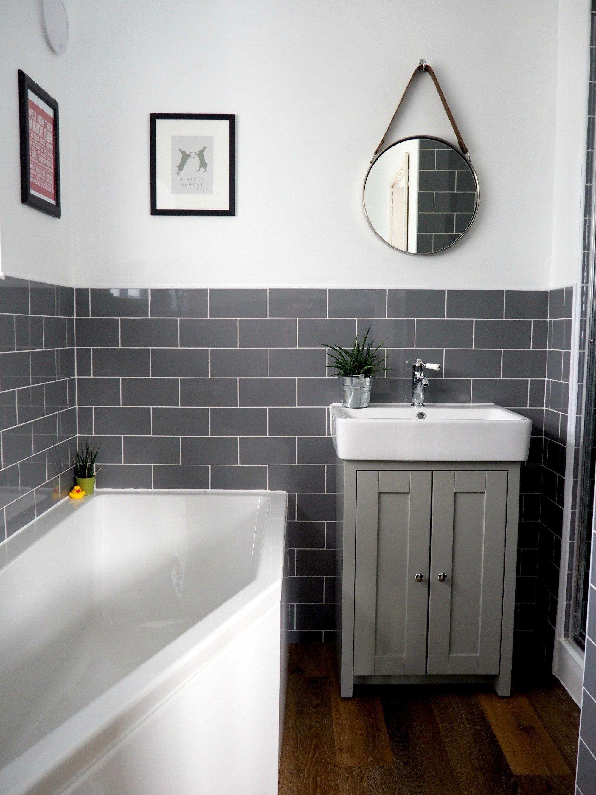 our brand new bathroom renovation grey subway tiles