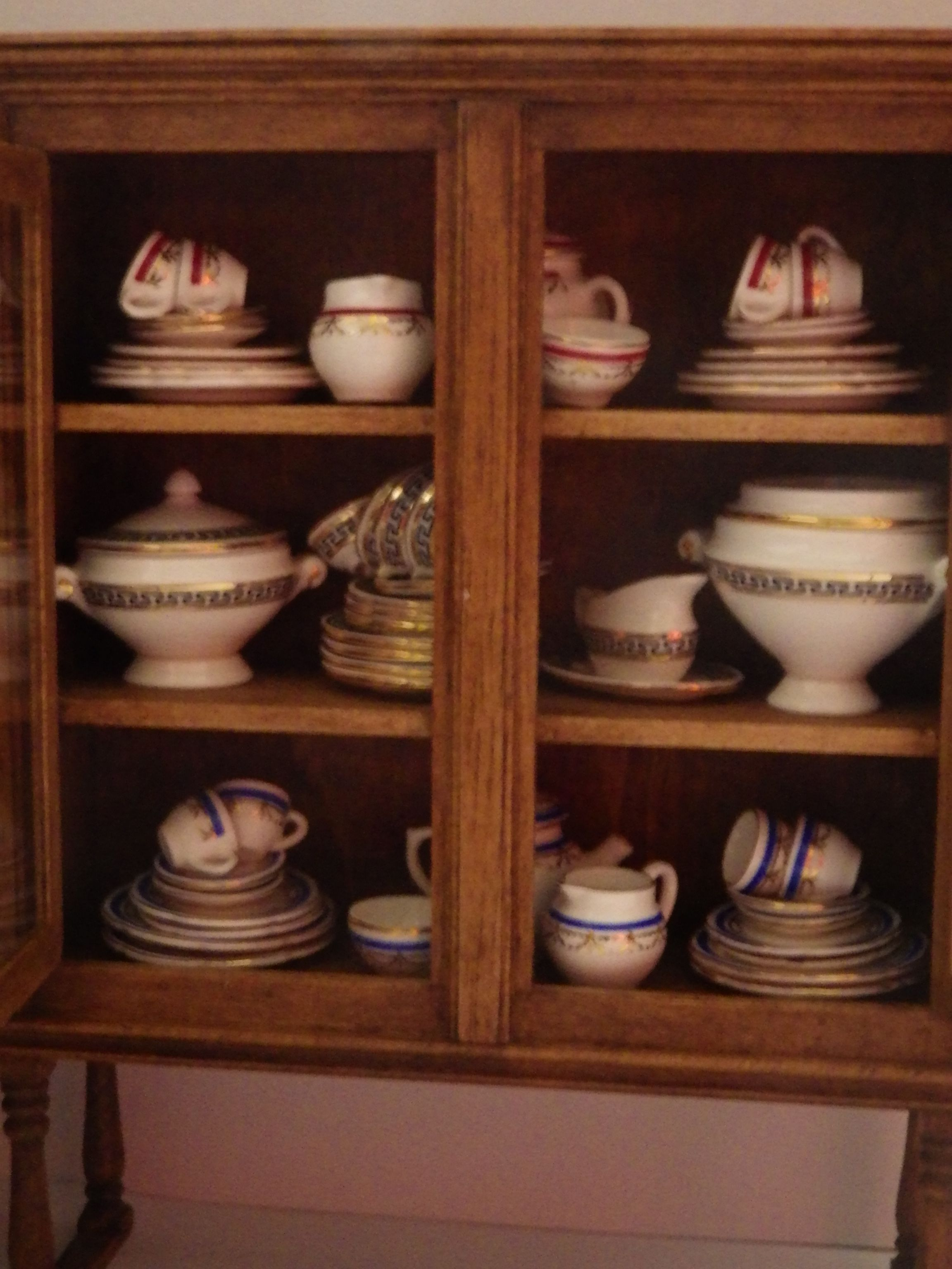 One of the china cabinets in the butlers pantry of Poppyfield Dr