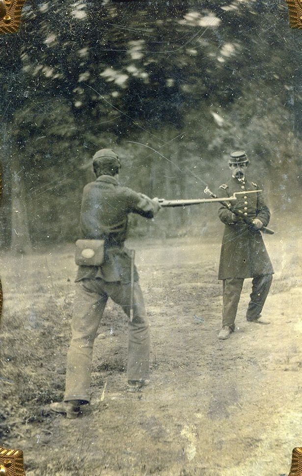 Two Federals Demonstrate Positions Of The Bayonet Drill Lunge And
