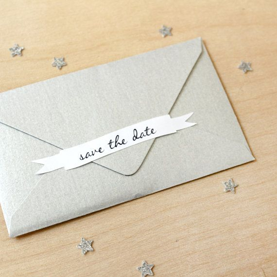 A sticker adds a sweet touch to a save the date.