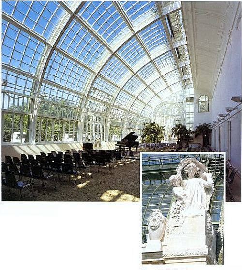 Interior view of the Grosse Orangerie, Vienna, Austria built in 1744 by Pacassi.  Orange trees blossomed along the walls and a long banquet table was place in the middle of room.  Chandeliers hung from the ceiling.