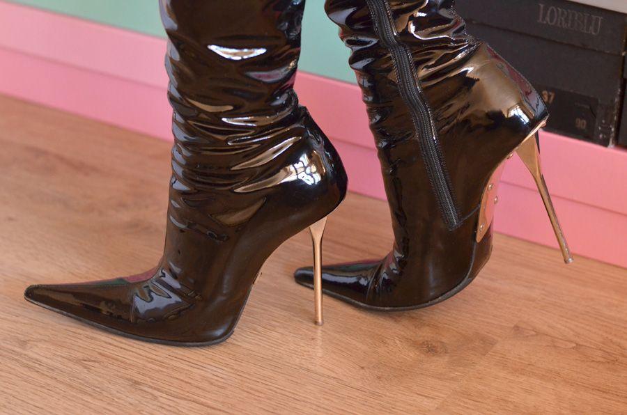 used gianmarco lorenzi boots with metal high heels for