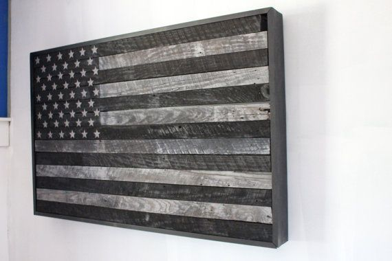 This is a one of a kind handmade hidden gun cabinet. It features a subdued American flag made from reclaimed barn wood. The interior allows your to