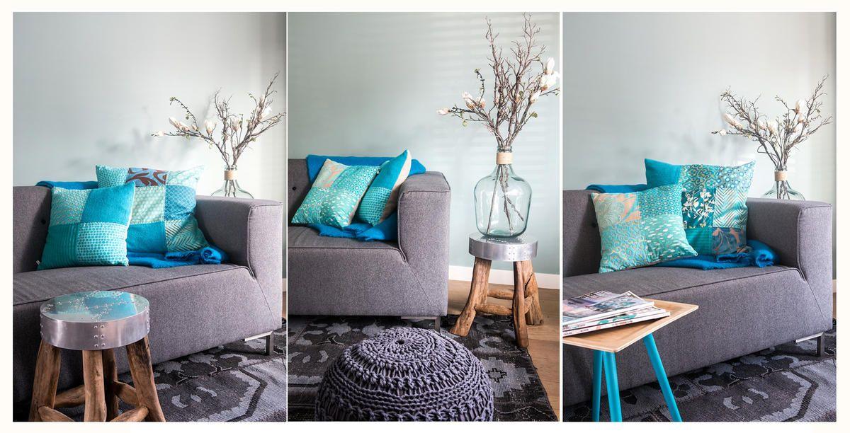 Kleuradvies Woonkamer Voorbeelden: Woonkamer met grijze muur pure ...
