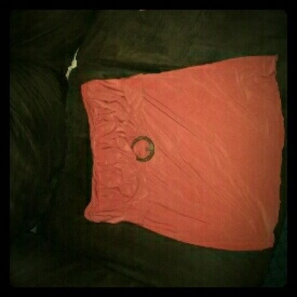 Top Orange stretchy tube top.  I wore it twice while I was pregnant. Very good condition.  Maurices brand.  It says size 1 but it's more of a large. It's made of 95% polyester and 5%  spandex.  No special wash instructions. Has a brown round belt type buckle. Maurices Tops Blouses