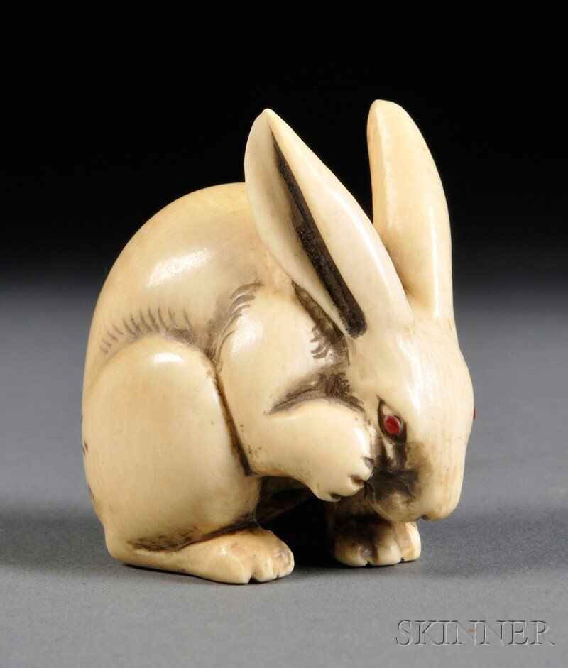 Ivory Netsuke, Japan, 19th century, carved in the form of a seated rabbit with raised front right leg, signed Gyokuzan, ht. 1 1/2 in.