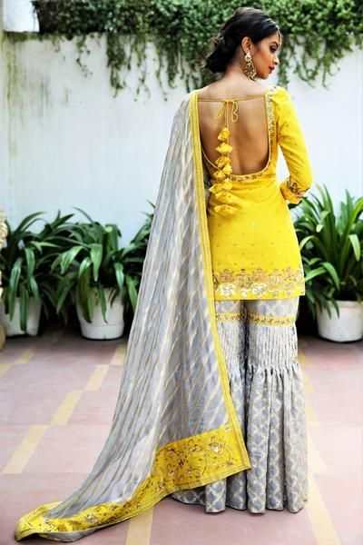 Buy sunflower yellow short kurta with grey tissue net garara online in USA. Get wedding ready with a stunning range of Indian designer suits and lehengas from Pure Elegance fashion store in USA. We bring the best dresses for brides in USA at our online store. Shop now.-back #shararadesigns