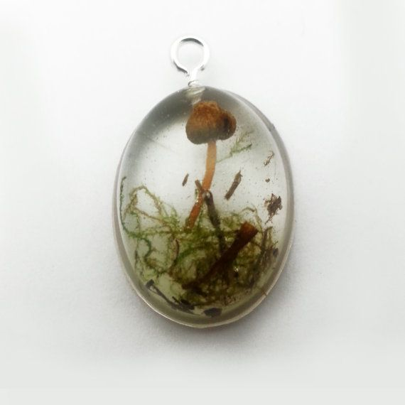 Super tiny fairy garden necklace! Great for any festival, rave, or any other occasion.  Mushroom harvested by hand from Southern Washington & forever encased in crystal clear resin. Very unique little piece of jewelry. Would be a fantastic conversation starter!  This necklace includes a 20 hemp cord, metal chain, or can be put on a key-chain. Please be sure to select your choice when purchasing. ♥ This pendant would do best if removed before showering or swimming. ♥  *Please note that due…