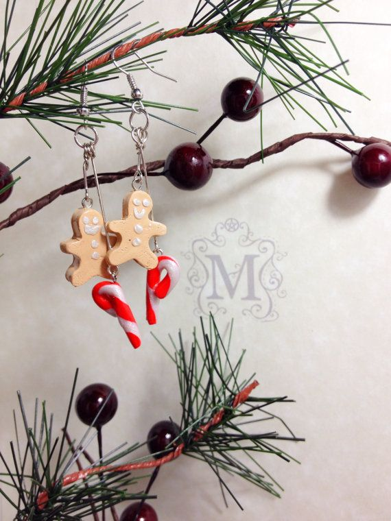 "Bring a bit of sweetness into your holiday season with these adorable handcrafted polymer clay candy cane and gingerbread man earrings.  Measuring just over 2"", each charm is glazed with a topcoat for a beautiful and durable shine."