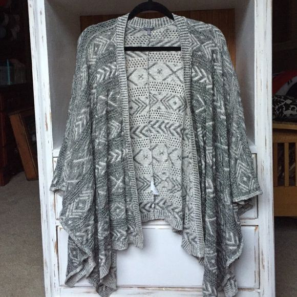 Tribal cardigan White and gray tribal pattern sweater. Worn once, no stains or pilling. Offers are welcome, but please use blue offer button to negotiate price. No trades. Charlotte Russe Sweaters Shrugs & Ponchos