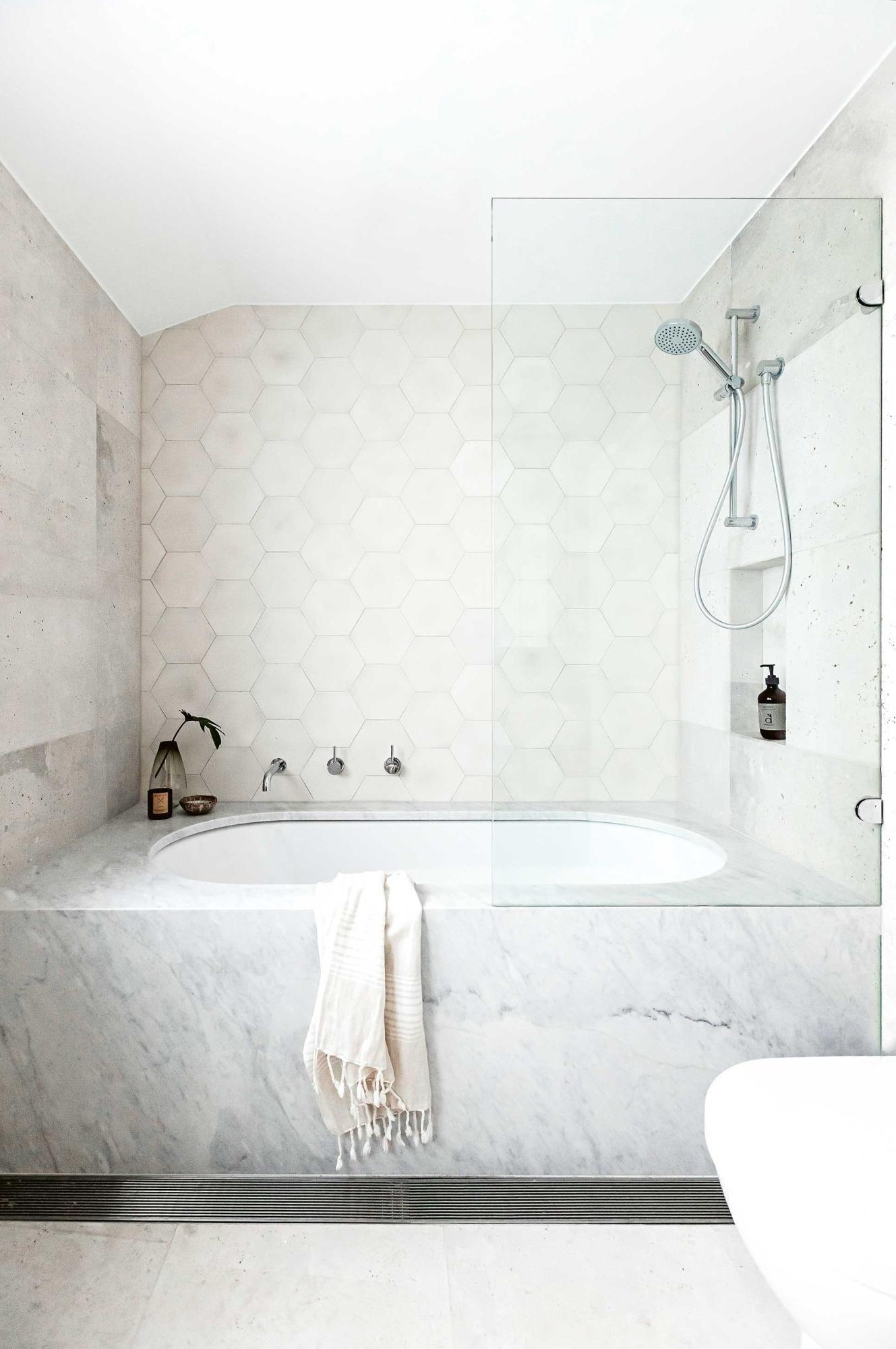 This bathroom uses u0027Uni coloured Hexagonu0027 concrete tiles
