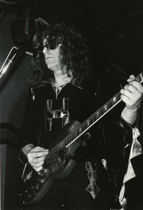 "Ian Hunter wearing his ""H"" shirt with caped sleeves 1972"