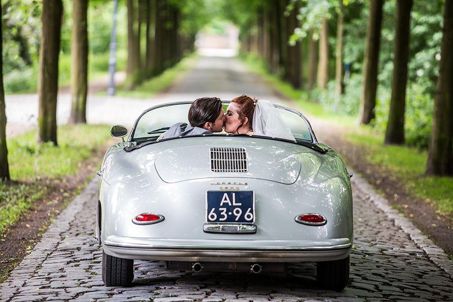 First Kiss In Vintage Wedding Car