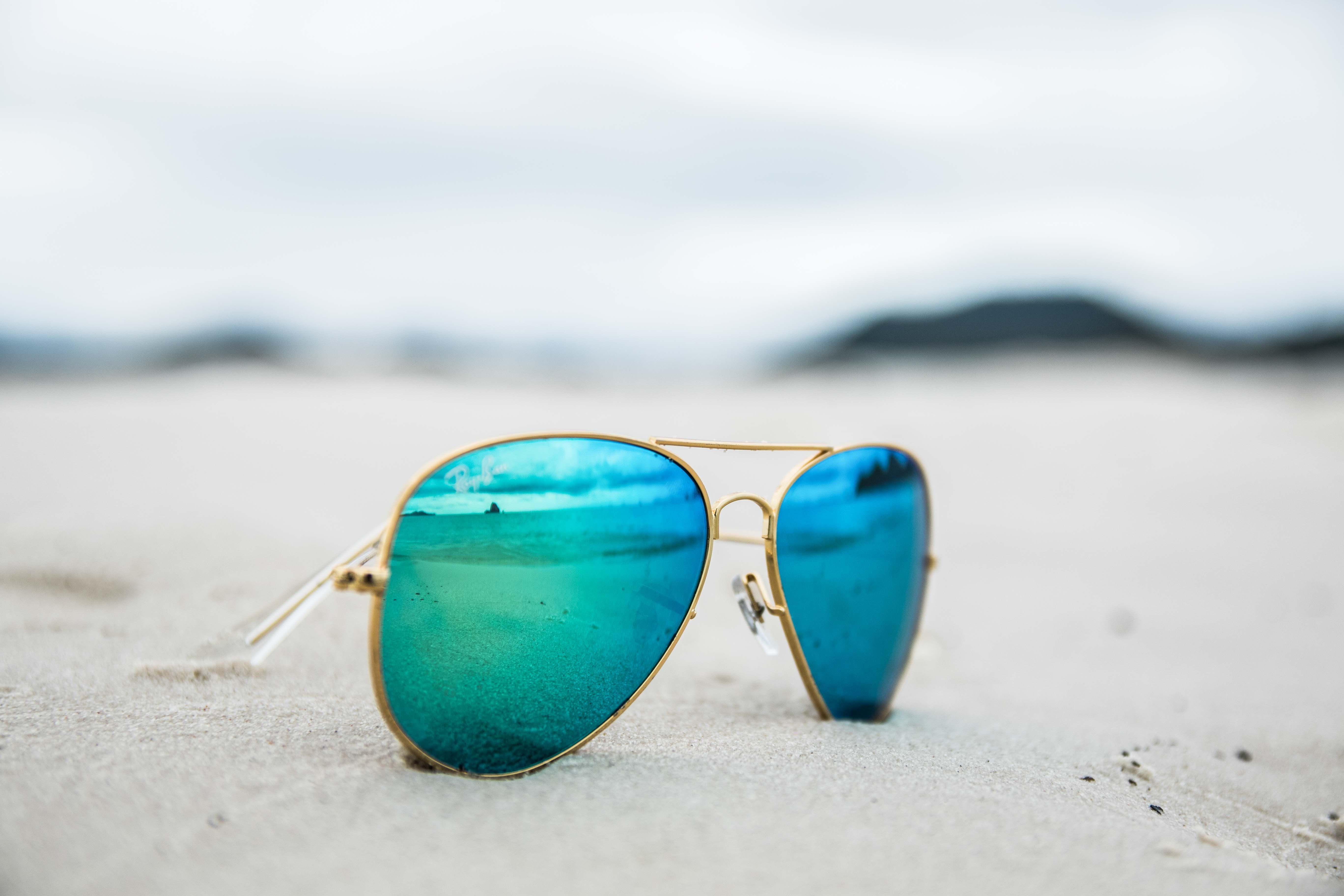 ray bans on the beach photography