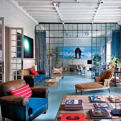 Love this room. Check out the leather worn leather chair with the bright blue velvet cushion. Clean rust.