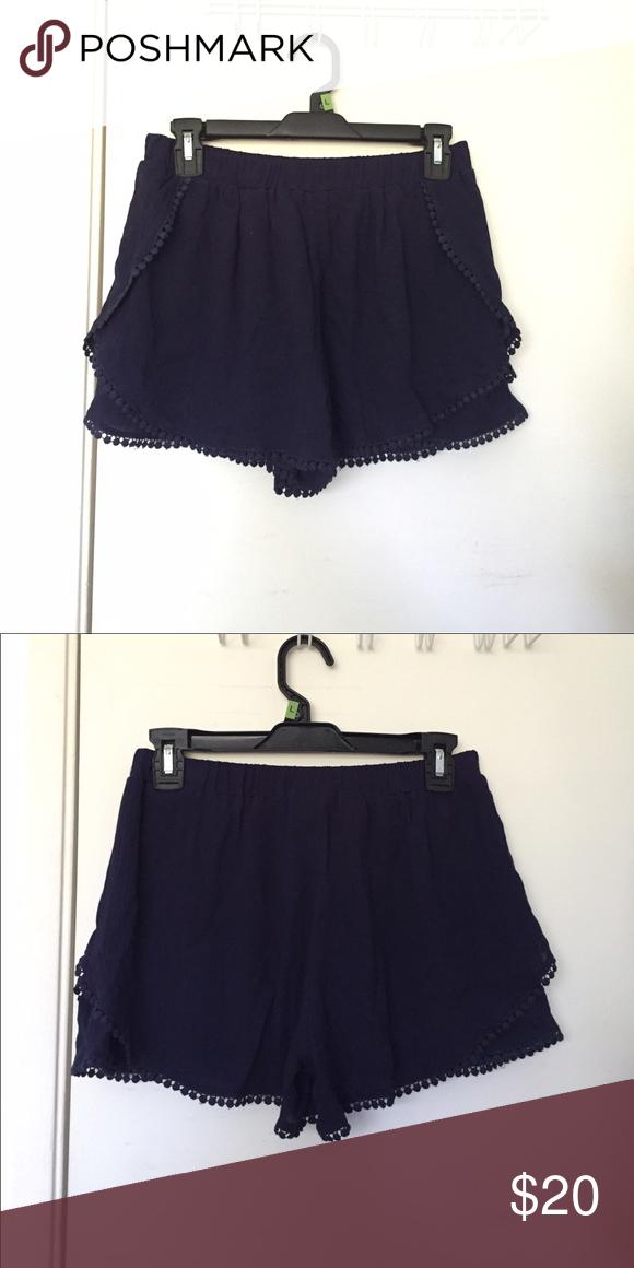 New navy high waisted tulip shorts NWT navy high waisted lace trim tulip shorts, size medium. Has an elastic waistband Shorts