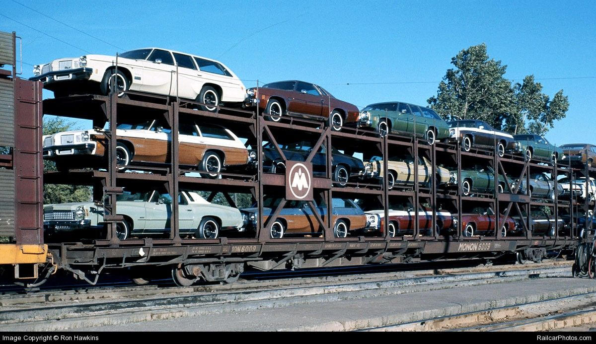 Railroad rack type flat car assembly for transporting