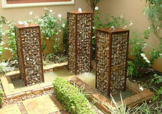 gabion stone garden water feature.  Great website - you can buy from them and they ship the all over OZ.