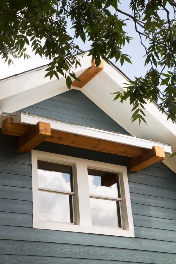Check Out This Metal Awnings Supported By Natural Wood Beams