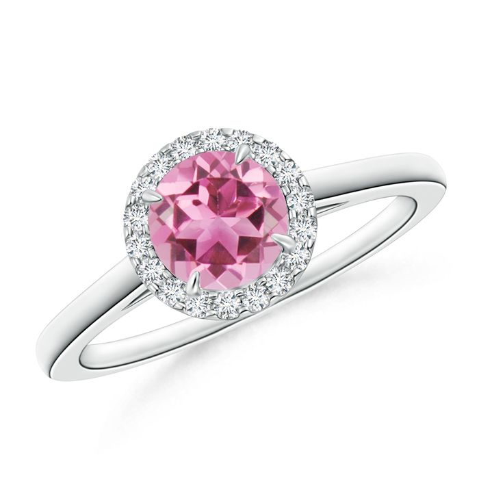 Handcrafted in lustrous 14k gold, this pink tourmaline and diamond halo ring is a look she is sure to love and flaunt more often. As a daytime accessory or a sparkle to brighten up your evenings, this vintage inspired cathedral ring is princess-perfect.