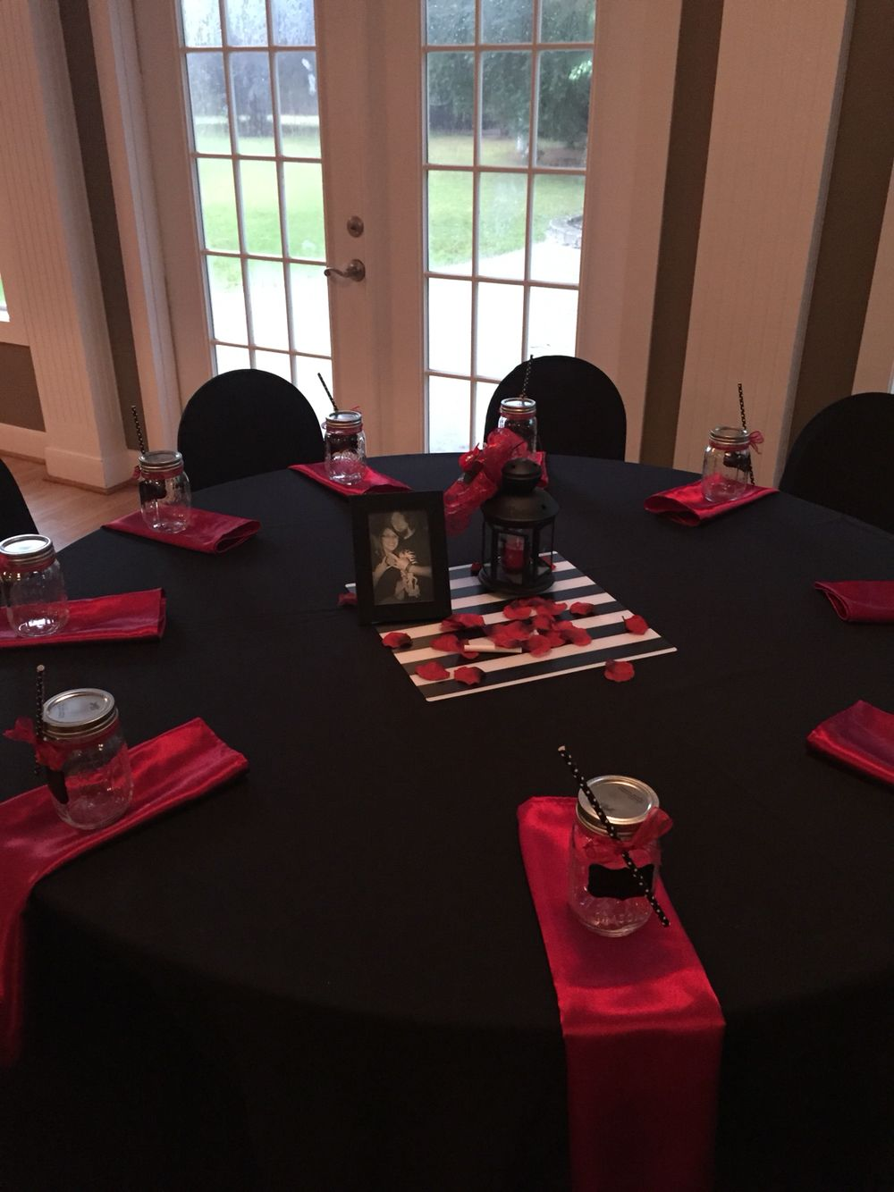 Black and red with mason jar favors