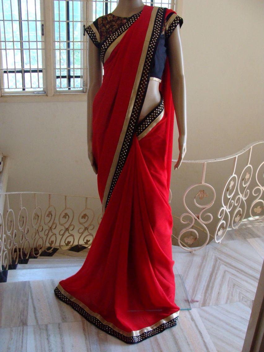 Red silk saree with kundhan kari patch work and boatneck embroidary blouse.