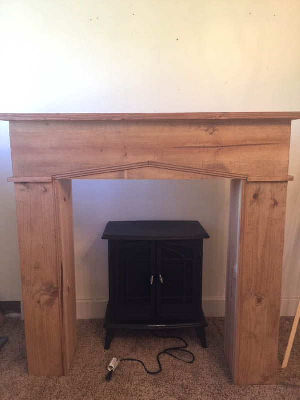 Add warmth, character and style to your home with this easy DIY faux farmhouse style fireplace and mantel. Raw wood, shiplap, and a freestanding fireplace!