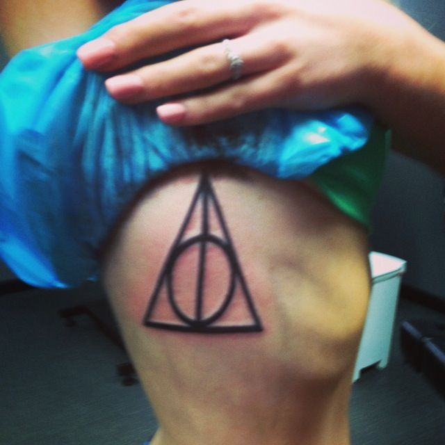My deathly hallows tattoo on my ribs