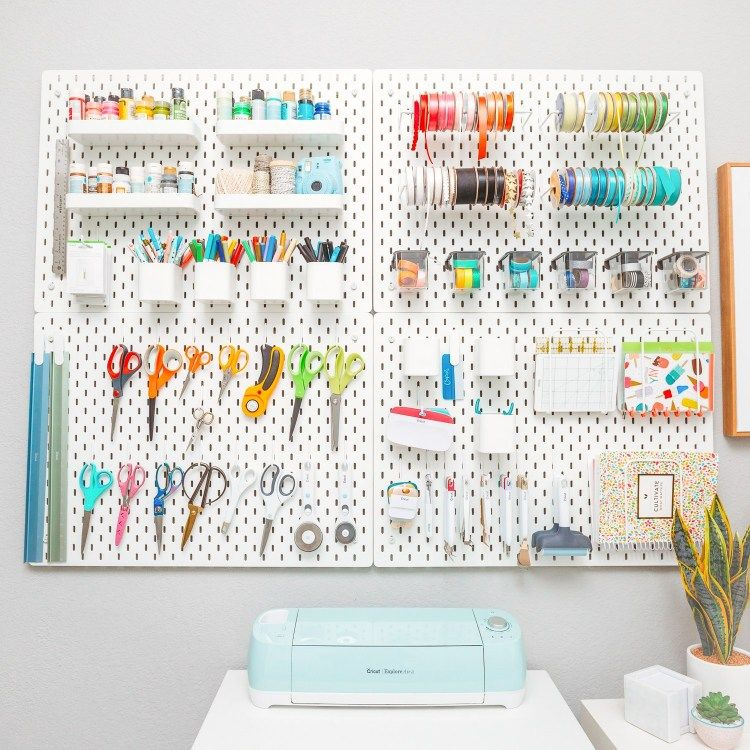 IKEA SKADIS pegboard holding craft supplies—great craft room organization! #ikeaideen