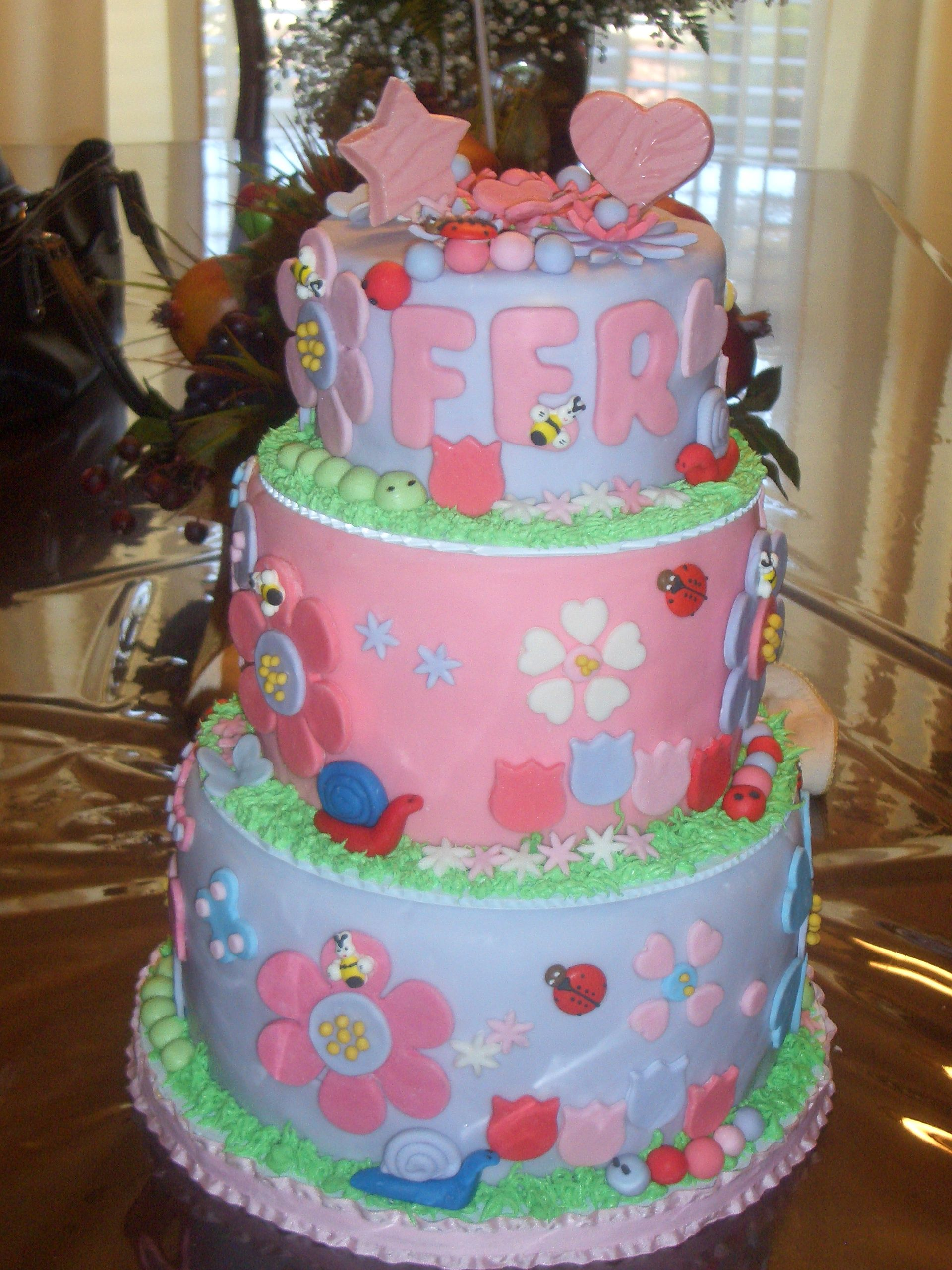 A Three Tier Birthday Cake For A Little Girl
