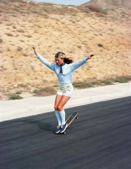 Ellen O'neill awesome free style skater from San Diego I think this was in the hills of La Costa before they built houses we used to do pirate downhill slalom races there...no helmets, no protection other than a pair of vans, OP shorts and a tee shirt ...good times.