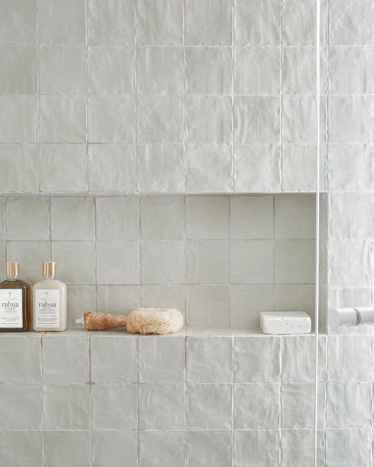 textured white shower tile