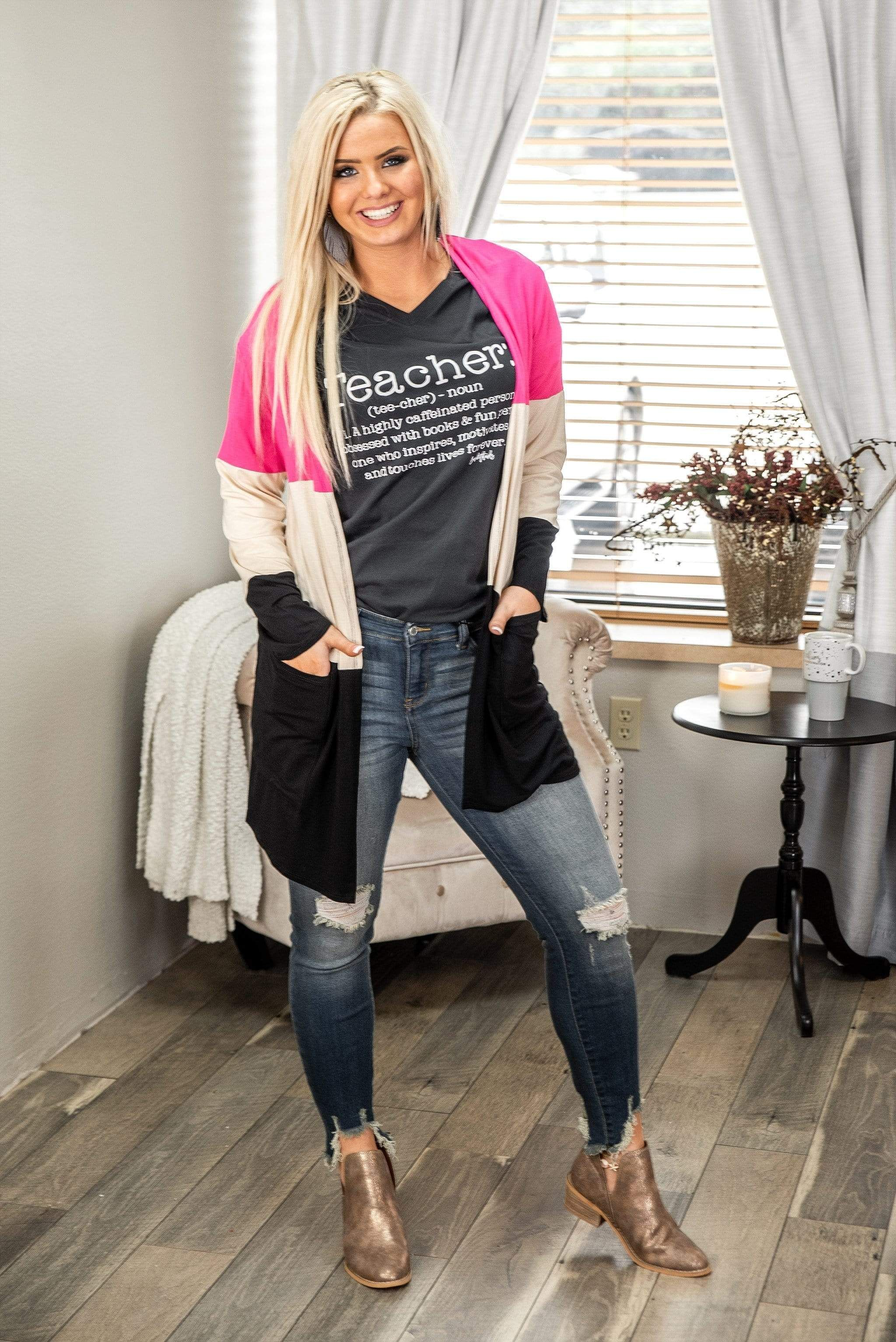 This cute colorblock cardi is the perfect topping for any outfit that needs a pop of pink! Open style, 40